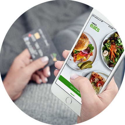 Person ordering takeaway on a mobile using a credit card